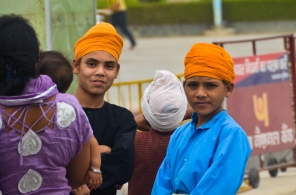 Boys in orange turbans.