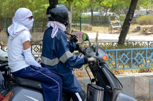 Wrapping up is common on motorcycles. Helmets are required for men, but not women.